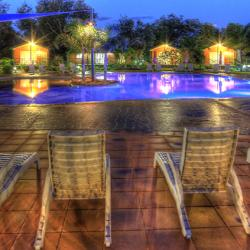 Relax on the lounge chairs beside the resort style swimming pool